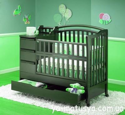 Дитяче ліжечко з шухлядами та місцем для пеленання